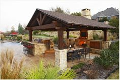 covered outdoor kitchens with pool. We specialize in outdoor living rooms  kitchens and backyard patios Create your dream space One Stop Shop pool house ideas Kitchen House Plans with Pools