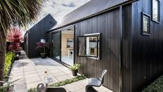 Completed in 2016 in Christchurch, New Zealand. Images by Stephen Goodenough. The idea of the 'Urban Cottage' stems from a shared fascination between the Architect and Client with early colonial workers cottages, and an. New Zealand Architecture, Architecture Résidentielle, Cabinet D Architecture, Cabana Urbana, Piscina Interior, Urban Cottage, Prefab Homes, Small House Plans, Black House