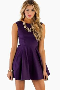 Mini skirt purple party dress with golden chain necklace