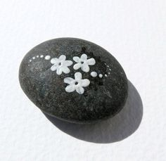 Colored river sea ocean stones painted rock cool art home decor for luck. $35.00, via Etsy.