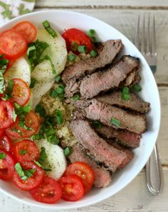 Steak & Quinoa Protein Bowl #SundaySupper #GrillTalk - Thinly sliced grilled sirloin steak served on a bed of quinoa topped with fresh vegetables that have been drizzled with olive oil and seasoned with fresh basil.
