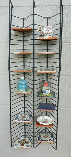Repurposed cd rack as curio shelf with Mexican tiles