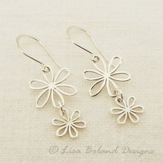 Sweet daisy earrings, light and perfect. Solid sterling silver. The earrings are 1 and 1/2 inches long and just over 1/2 inch wide.