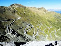 Stelvio Pass The Stelvio Pass at an elevation of 9.045 feet is one of the top 50 highest mountain roads in Europe. The road leading over the pass is the highest paved mountain pass in the Eastern Alps and the only thing keeping you from toppling  over the edge is a small concrete barrier. It has over 48 mind bending hair pin turns.