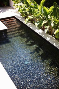 slate pool this is it. Slate used inside the pool awesome! in many different colors. so much better than pebbles to me.