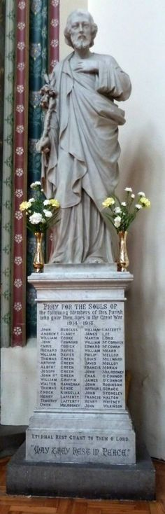 Imperial War Museum Reference12987. The First World War Memorial in St Alban's Church is in the form of a marble statue of St Joseph standing on a marble plinth which is inscribed with the n…