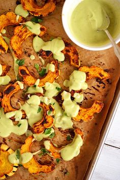 Curry-Spiced Delicata with Avocado Lime Sauce | A sweet and creamy squash rubbed with curry and roasted to perfection! Drizzled with an super simple avocado sauce. The perfect contrast of flavors and SO EASY! | simplytothrive.com