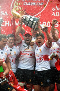 Jaco Kriel Photos - Jaco Kriel of the Lions celebrates with the trophy during the Absa Currie Cup Final match between Xerox Golden Lions and DHL Western Province at Emirates Airline Park on October 24, 2015 in Johannesburg, South Africa. - Absa Currie Cup: Xerox Golden Lions v DHL Western Province Jaco, Golden Lions, Emirates Airline, Australian Football, Famous Sports, Rugby League, Team Logo, South Africa, Soccer