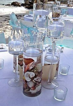 Beach themed centerpiece, seashells and candles.
