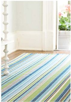 I have this rug in our room...Striped Rug in Beach Colors