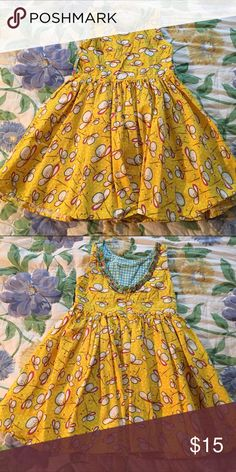 Jelly The Pug Yellow Print Dress Sleeveless yellow print dress with contrasting fabric at neckline. Zips in back. Gathered at waist for a full skirt. 100% cotton. Jelly The Pug Dresses Casual