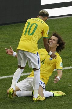 Brazil's David Luiz, right, celebrates with his teammate Neymar after Brazil scored the opening goal during the World Cup round of 16 soccer match between Brazil and Chile at the Mineirao Stadium in Belo Horizonte, Brazil, Saturday, June 28, 2014. (AP Photo/Hassan Ammar)