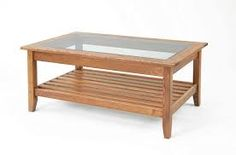 Add our solid ash glass display coffee table to your living room. Showcase prized possessions or collectibles in this durable table with below storage. Coffee Tables Uk, Coffee Table With Shelf, Coffee Table Plans, Coffee Table Furniture, Glass Top Coffee Table, Modern Wood Furniture, Diy Pallet Furniture, Furniture Ideas, Glass Table Set