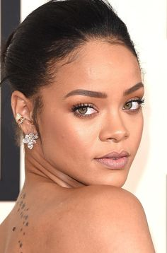 Rihanna wears diamond ear cuffs and climbers by Chopard to the 2015 Grammy Awards
