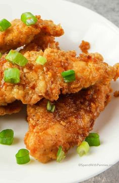 These Ginger Honey Garlic Chicken Tenders are easy to make from scratch and definitely a family favorite! Tender filets of chicken are double dipped, cooked until crisp and tossed in a delicious homemade honey garlic sauce. Easy Honey Garlic Chicken, Honey Garlic Sauce, Chicken Tender Recipes, Ginger Sauce, Chicken Meals, Butter Chicken, Garlic Butter, Ham And Potato Soup, Chicken Tenders