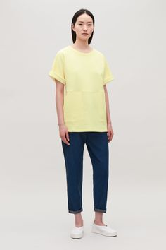 Model front image of Cos a-line jersey top with pockets in yellow
