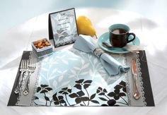 Elegance and Afternoon Tea Party - Don't brew over creating the perfect teatime setting! Bonding those delicate papers and ribbons together is as easy as the pie you'll be serving with tea, thanks to Aleene's® Crystal Clear Tacky Spray™. Choose your favorite prints and colors, then spray away, knowing your guests will only see the tasteful décor, not the glue that holds it together! Designed by Duncan
