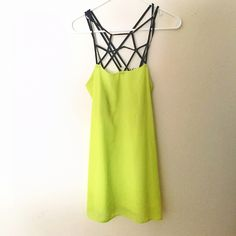 cage top neon dress black strappy cage top neon dress. super comfortable and cute Lulu's Dresses Mini