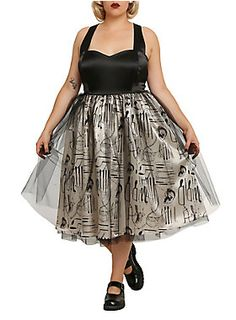 "<p><span id=""webDesc"">Satin dress from the Hot Topic exclusive <i>American Horror Story</i> collection with a black top, ivory bottom with doctor tool and skull print, black tulle overlay and crisscross back straps."