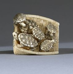 "IVORY NETSUKE Early 20th Century In the form of seven turtles resting on a winnowing basket. Signed. Length 1.5"" (4 cm)."