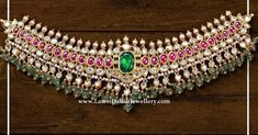 An elegantly designed kundan choker from Bombay jewellers in sparkly hues and is adorned with precious traditional stones. The beautiful kundan studded 22 carat gold choker is embellished with pearls and emerald drops. Jewelry Design Earrings, Gold Jewellery Design, Necklace Designs, Gold Jewelry, Gold Necklaces, Diamond Jewellery, Bridal Jewellery Inspiration, Bridal Jewelry Sets, Wedding Jewelry