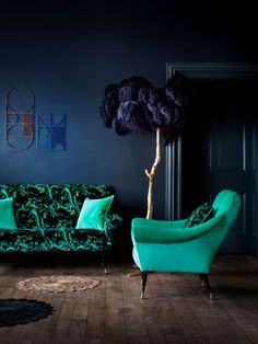 dark blue living room with jade green chair, pantone arcadia, blue-green, emerald green, mint green