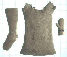 c1500, English. Rare surviving Tudor textile. Infants hand knitted set of bodywarmer, mittens and sock/leggings.