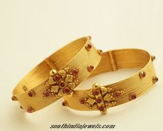 Check this stunning latest gold bangles design from PNG Jewellers. The bangles have antique finish and studded with rubies.