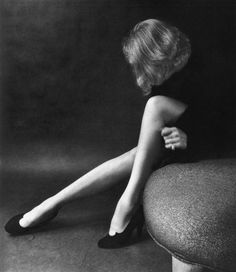 """Screen star Marlene Dietrich once stated that """"Mystery is a woman's greatest charm."""" During a 1952 photo session, photographer Milton Greene captured this idea by playing on the idea of Dietrich's face being hidden and shrouded in mystery."""