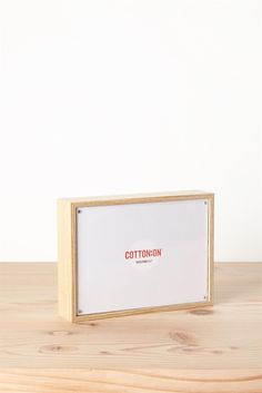 This classic rectangle profile photo frame has a slim minimalist design and free-standing back. Available in White and Timber Dimensions: 5 x 7 inches