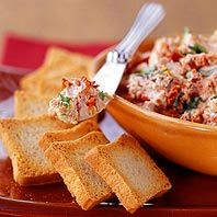 Tomato and Basil Chevre Spread Recipe - Sun-dried tomatoes and basil turn ordinary cheese into a special treat.