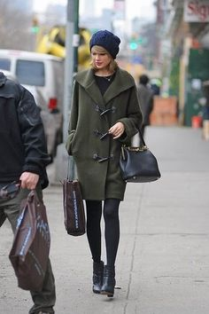 Taylor Swift wearing Dark Green Duffle Coat, Black Long Sleeve T-shirt, Black Leather Ankle Boots, Black Leather Tote Bag