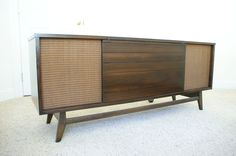 1960's Vintage Radio & Record Player Console   SOLD. $550.00, via Etsy.