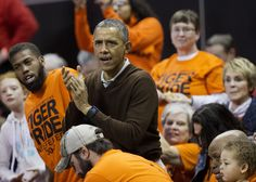 President Barack Obama cheers on his niece Leslie Robinson at the Princeton game against Wisconsin-Green Bay women's college basketball game in the first round of the NCAA tournament