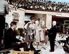 """Veronica Cartwright (b. 1949), Rod Taylor (b. 1930), Tippi Hedren (b. 1930), Jessica Tandy (1909-1994) and  Alfred Hitchcock (1899-1980) on the set of """"The Birds"""" (1963)"""