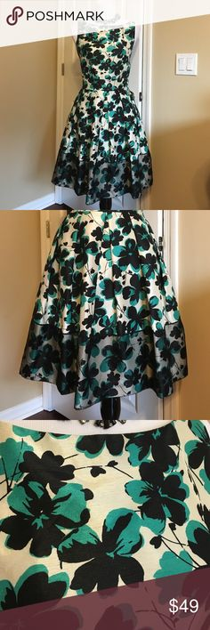 Classic A Line Green, Black & Cream Dress Classic A Line Green, Black & Cream Dress!  Be a show stopper in this classic beauty!  Fabric is made to look like silk but is 100% polyester.  Excellent condition!  Measurements when laying flat:  armpit to armpit 19 inches, waist 16 inches, length from neckline to bottom 35 inches.  Necklace sold separately.  No trades.  All reasonable offers welcomed! Taylor Dresses Dresses Midi