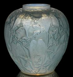 René Lalique  'Perruches' a Vase, design 1919  opalescent glass, frosted and heightened with blue staining  25cm high, moulded and engraved 'R. Lalique'