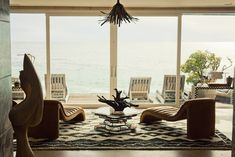 subdued color palette, myriad of textures, vintage furniture, organic sculptures, and textural details {Kelly Wearstler Malibu House}