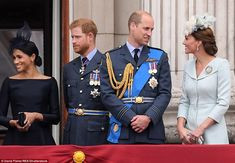 The group later assembled on Buckingham Palace balcony where they awaited a fly-over from ...