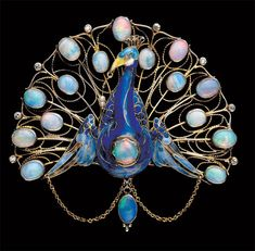 Art nouveau opal, gold, seed pearls and enamel peacock brooch: Tadema Gallery ~ JV Peacock Jewelry, Bird Jewelry, Opal Jewelry, Animal Jewelry, Sea Glass Jewelry, Jewelry Art, Antique Jewelry, Vintage Jewelry, Jewelry Design