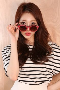Girl's Day YuRa. I love the way that the red of her lipstick and sunglasses match so well with the black and white shirt that she is wearing.
