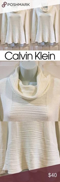   Calvin Klein   Lovely Cream Cowl Neck Sweater In brand new condition. Never been worn! No flaws at all. So beautiful and comfy. Perfect for fall and winter! Made from 60% cotton and 40% acrylic.  Looser fit. Price is firm unless bundled, so NO offers please! Calvin Klein Sweaters Cowl & Turtlenecks