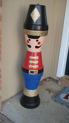 Create your own clay pot Christmas soldier by stacking clay pots on top of each other.