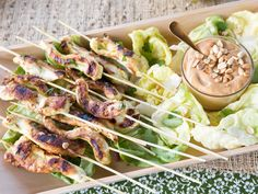 Served with a tangy coleslaw. Chicken Satay with Peanut Sauce Recipe : Tyler Florence : Food Network - FoodNetwork.com