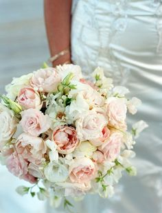 Classic shape, little greenery...peonies, roses, lysianthus and touches of lily of the valley.