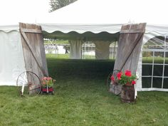 Old doors at entrance - a rustic spin on a tent wedding. #rusticwedding #tentwedding