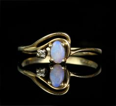 ERMERGERD. I am SO in love with this ring. Why don't I have $400 just lying around???  Vintage Opal and Diamond 10k Gold Engagement Ring. $415.00, via Etsy.