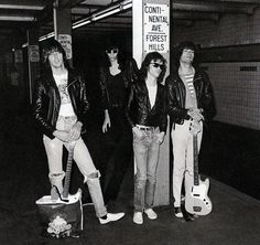 The Ramones wait on the subway platform in Forest Hills, Queens on their way to rehearsal in New York City, July 18, 1975. Photographed by Bob Gruen.