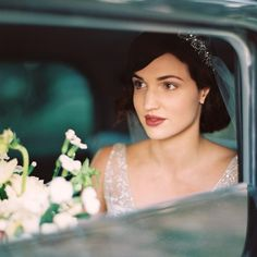 A very elegant arrival...see the whole day on my blog  {link in profile tap for vendors}. #perthwedding #film #filmphotography #arrival #vintage #reospeedwagon #1920s #glam #bouquet #perthphotographer #anticipation #love #shootmorefilm #contax645 #portra800 #weddingday #australiawedding by katiegrantphoto