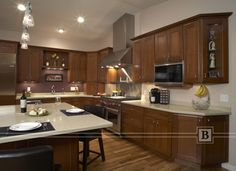 Medium stained cabinetry with stainless steel appliance.  http://www.belladomicile.com/Portfolio/kitchen/transitional